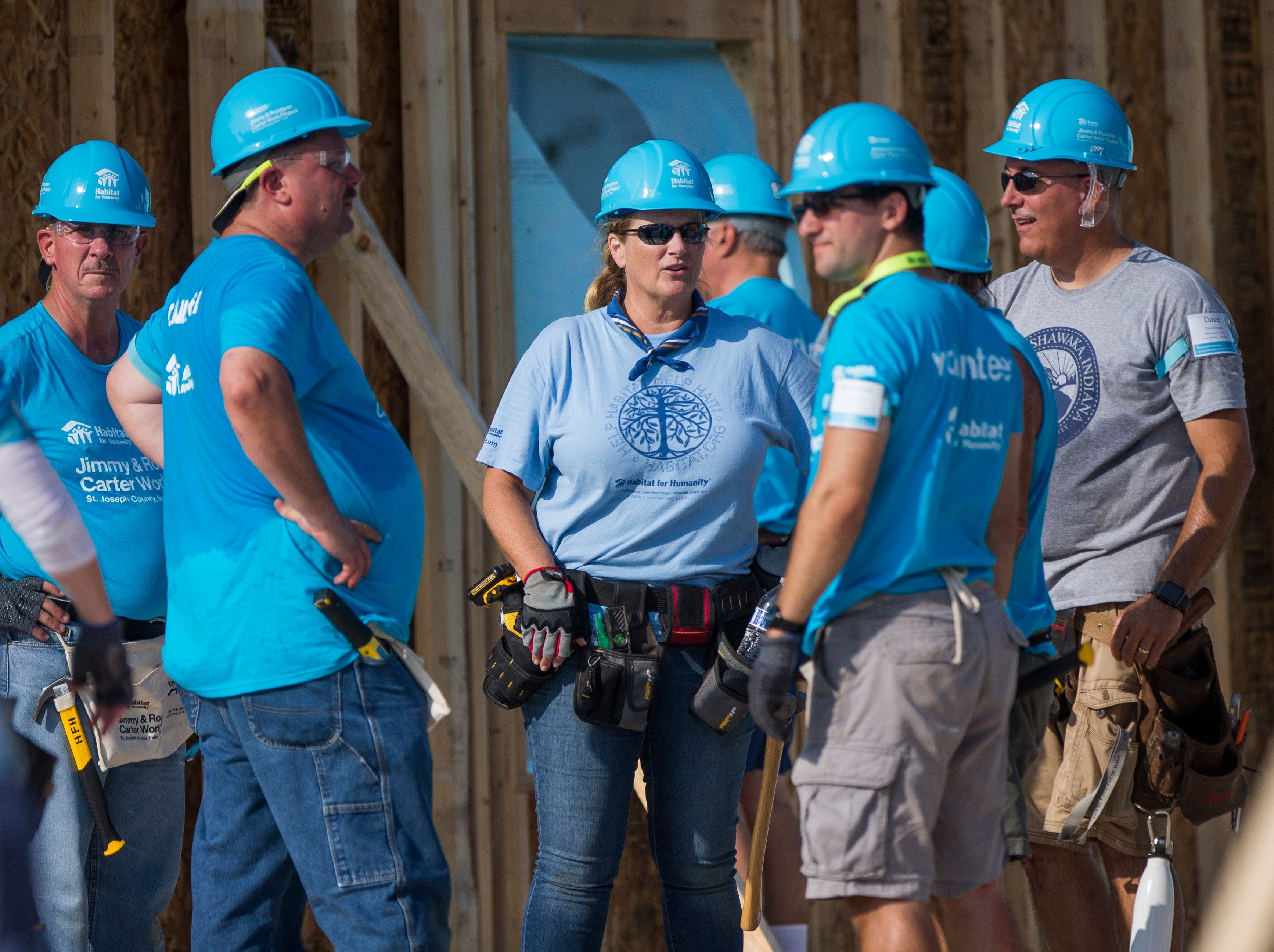 Country music star Trisha Yearwood, center, works with other volunteers on site during the first day of the weeklong Jimmy & Rosalynn Carter Work Project.