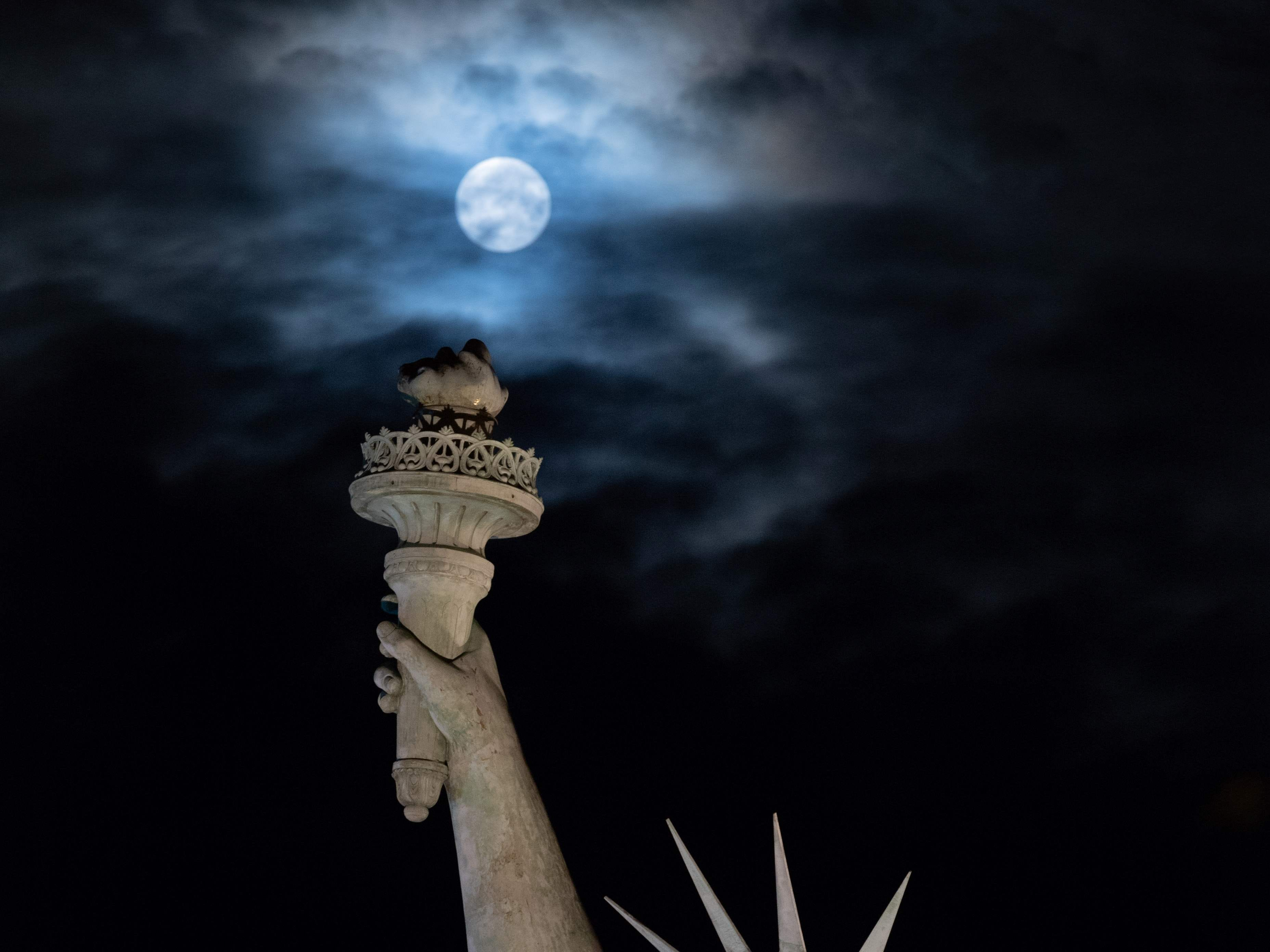 The full moon rises on Aug. 26, 2018, over the replica of the Statue of Liberty in Colmar, France, birth city of sculptor Frederic Bartholti.