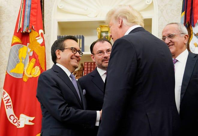 President Donald Trump greets Mexican Economy Minister Ildefonso Guajardo Villarreal, left, on Aug. 27, 2018.
