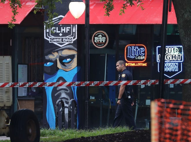 A Jacksonville sheriff's officer walks past the GLHF Game Bar on Aug. 27, 2018.