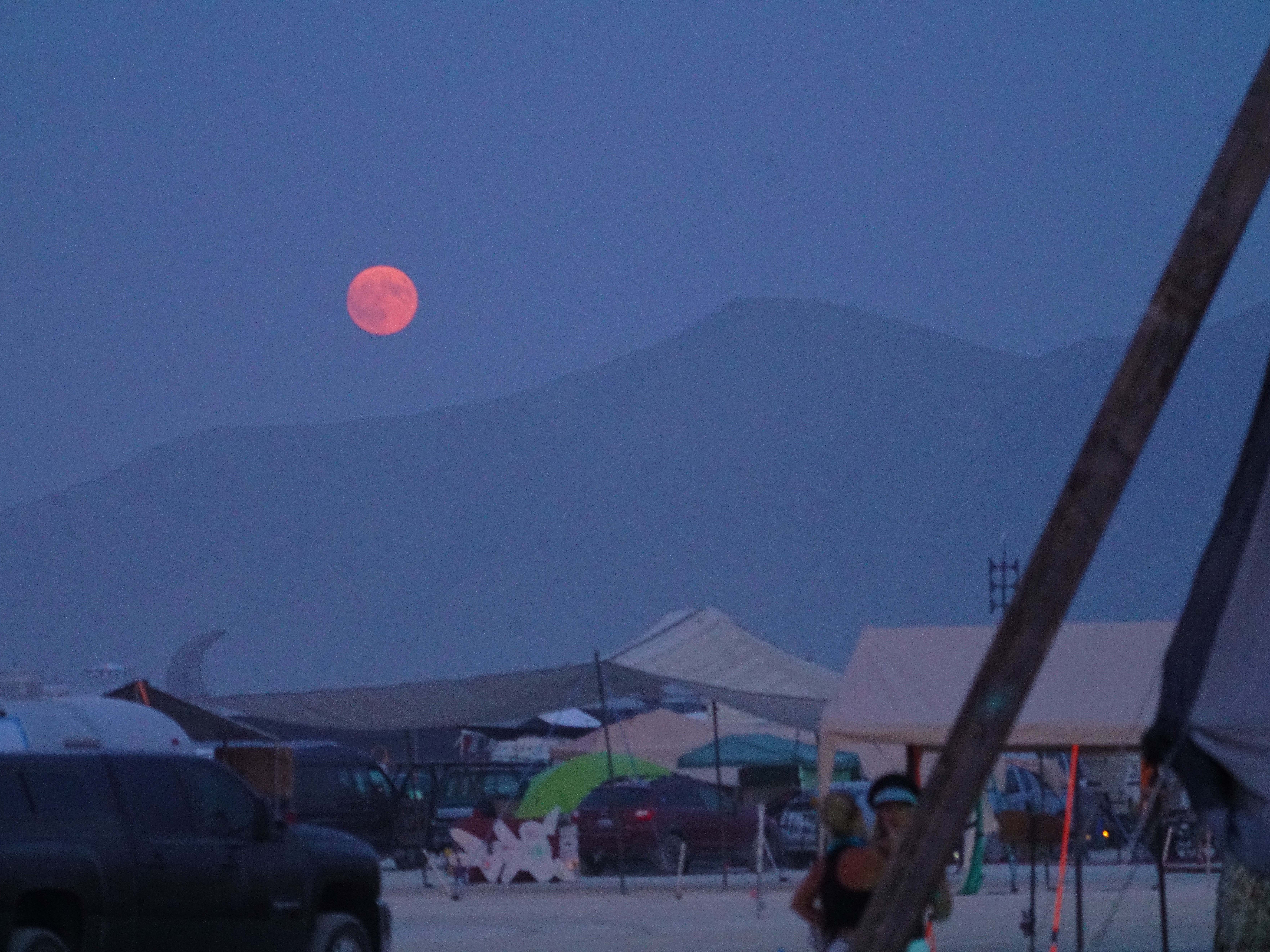 The full moon rises over the Burning Man festival site in northern Nevada, Aug. 26, 2018.