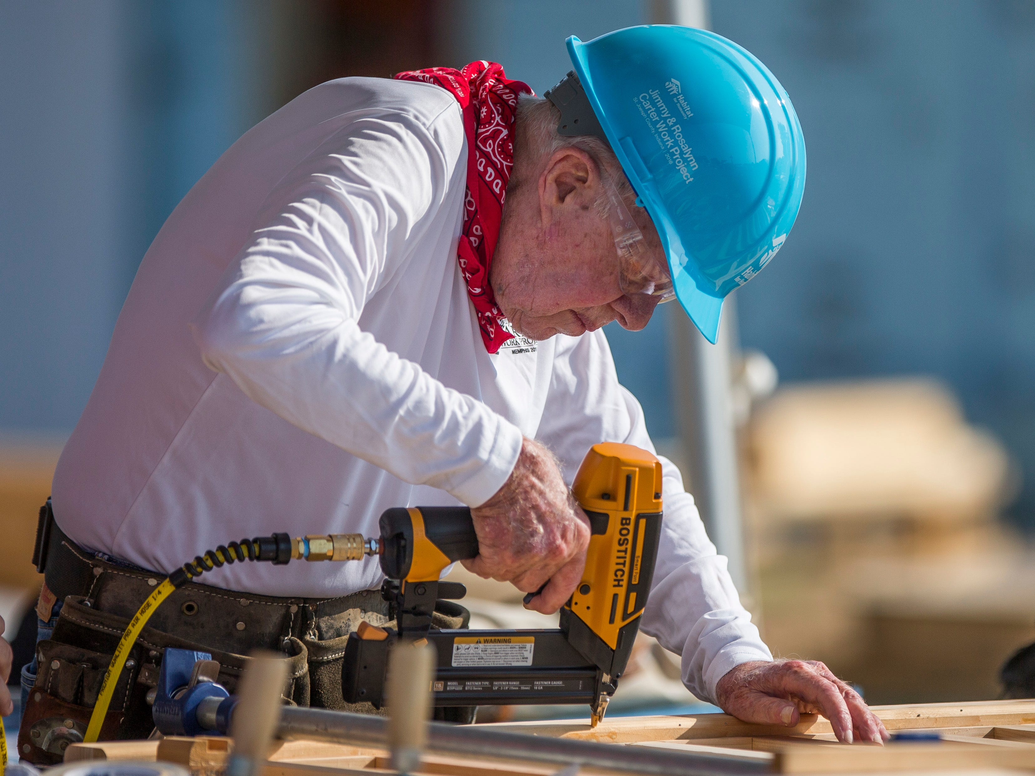 Former President Jimmy Carter works with other volunteers on site during the first day of the weeklong Jimmy & Rosalynn Carter Work Project.