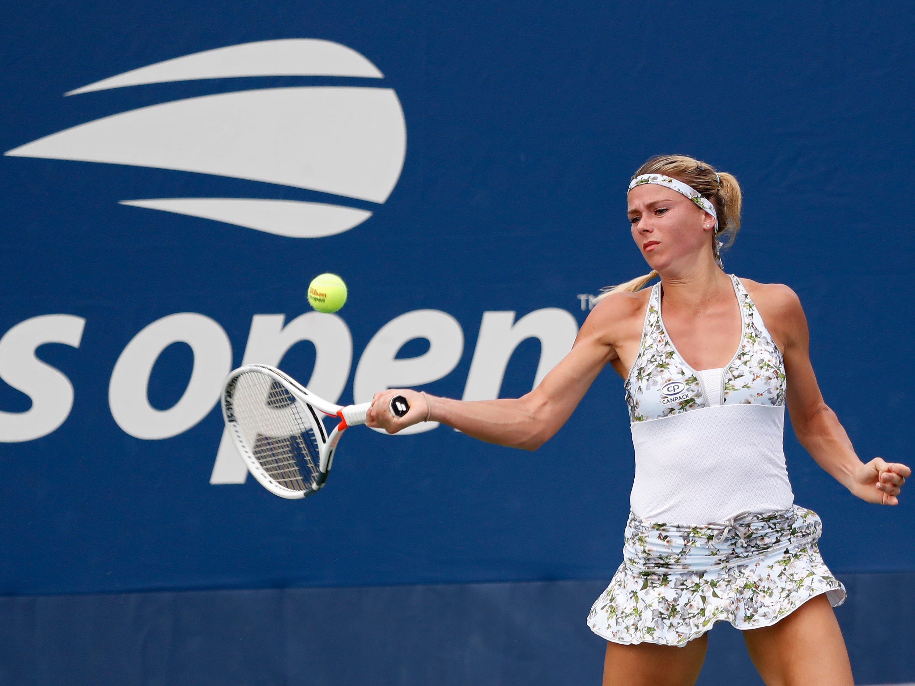 Camila Giorgi of Italy prepares for a forehand during her 6-4, 6-1 victory against Whitney Osuigwe of the USA.