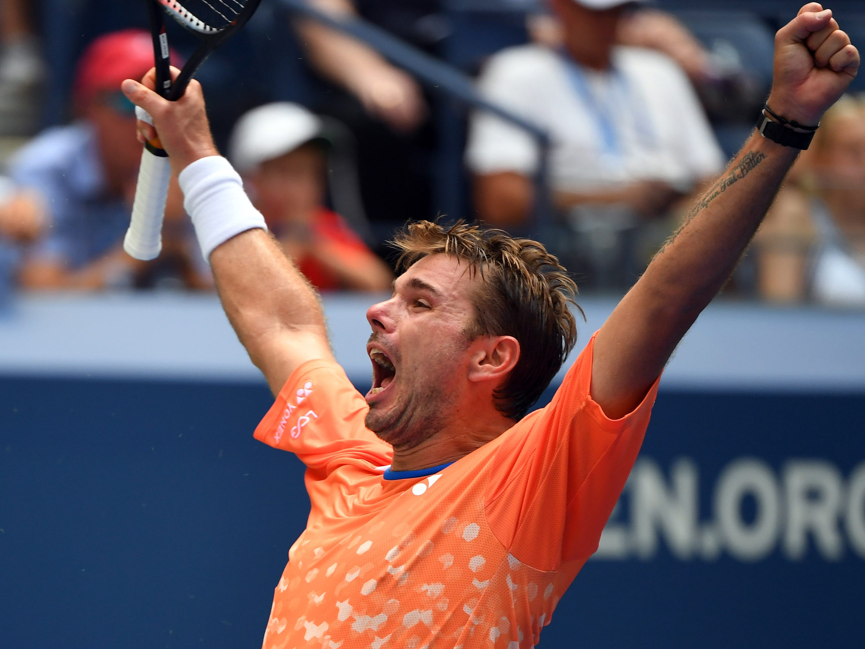 Stan Wawrinka of Switzerland celebrates big after handling his tricky first-round test against Grigor Dimitrov of Bulgaria. Wawrinka, the 2016 US Open champ, won 6-3, 6-2, 7-5.