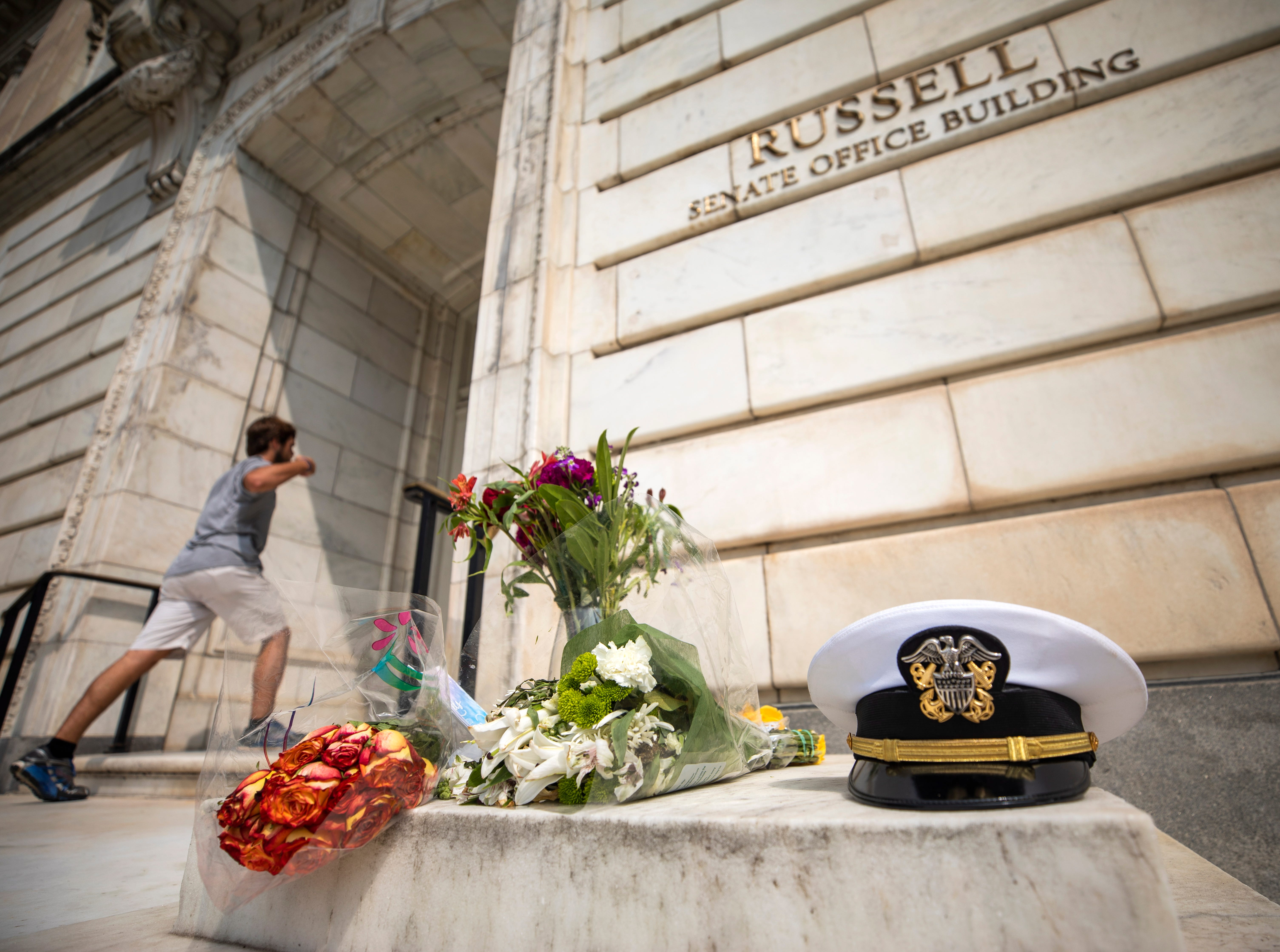 A small memorial for Republican Senator John McCain, who passed away at his home in Cornville, Arizona, USA, on 25 August at the age of 81, outside the Russell Senate Office Building in Washington, DC on Aug. 27, 2018. Democratic Senate Minority Leader Chuck Schumer said he will sponsor legislation to rename the Senate building after Senator McCain.