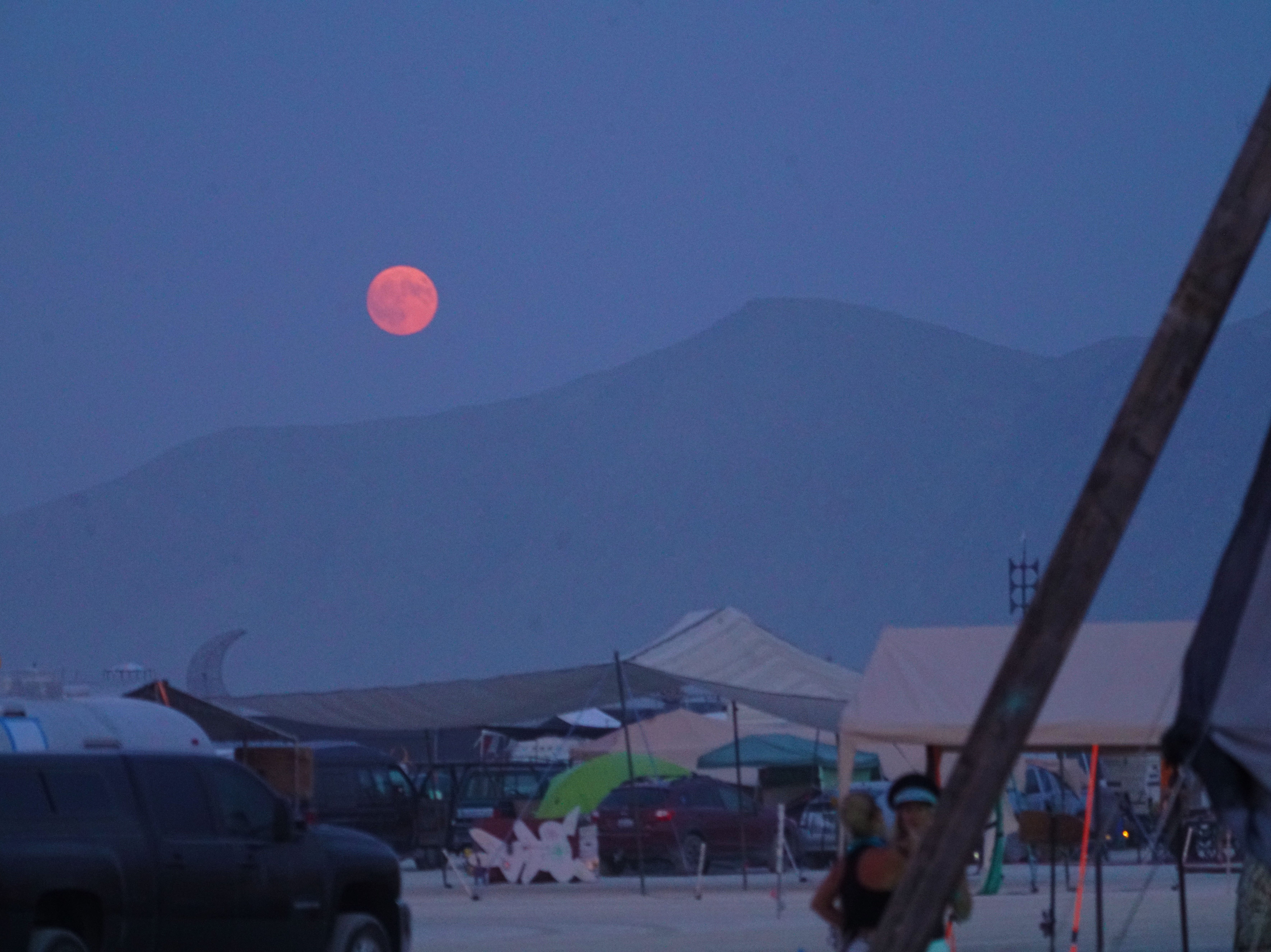 The full moon rises over the Burning Man festival site in Northern Nevada.