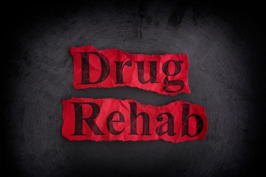 Torn Crumpled Pieces Of Paper With The Words Drug Rehab