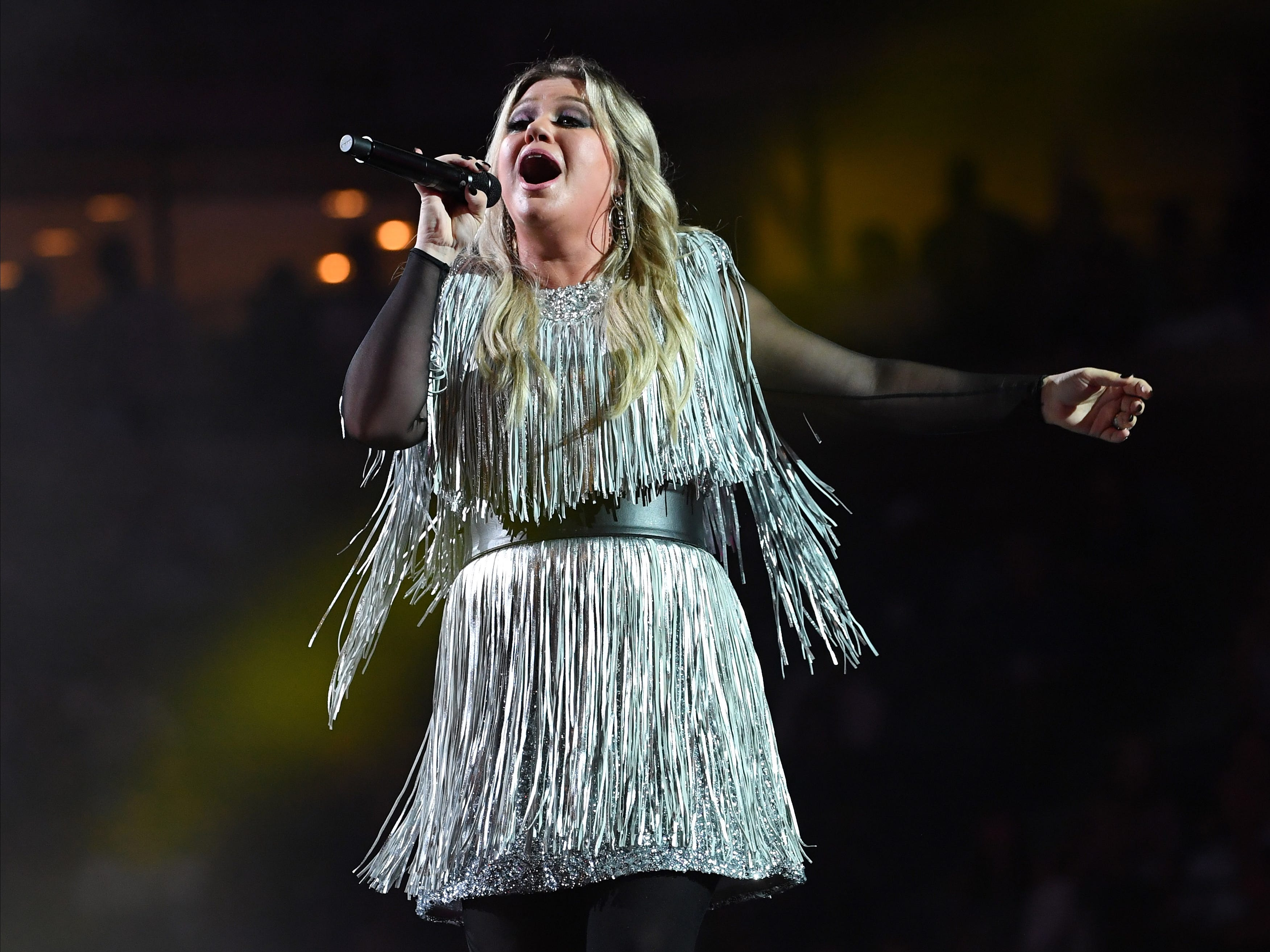 Kelly Clarkson performs at the opening ceremony at Arthur Ashe Stadium.