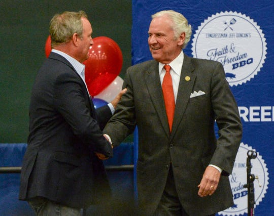 U.S. Rep. Jeff Duncan, left, thanks Gov. Henry McMaster after speaking during the Faith and Freedom barbecue fundraiser at the Civic Center of Anderson on Monday.