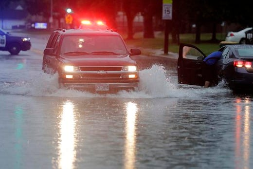 A motorist drives along a flooded Shawano Ave on the west side of Green Bay after heavy rain on Tuesday, August 28, 2018 in Green Bay, Wisconsin.