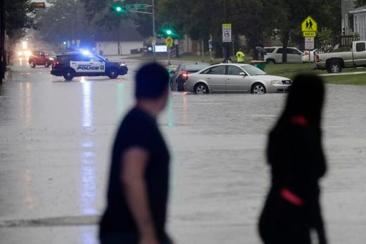 Stranded vehicles are shown at Shawano Ave on the west side of Green Bay after heavy rain on Tuesday, August 28, 2018 in Green Bay, Wisconsin