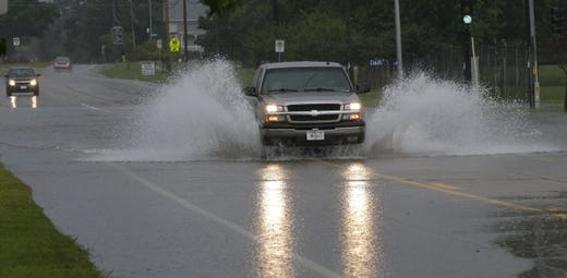 Trucks had little trouble crossing the street on Sawyer Street on Southland Avenue. Minor flooding occurred in Oshkosh and the surrounding area following a severe thunderstorm, torrential rains, and there were reports of tornadoes in surrounding counties, Tuesday, August 28, 2018, in Oshkosh, WI. Joe Sienkiewicz / USA Today NETWORK Wisconsin