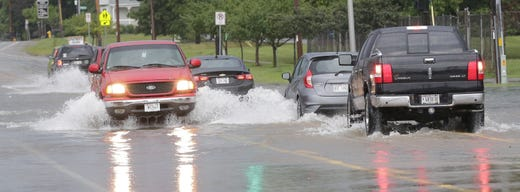 Vehicles traverse the street on Sawyer Street on Southland Avenue. Minor flooding occurred in Oshkosh and the surrounding area following a severe thunderstorm, torrential rains, and there were reports of tornadoes in surrounding counties, Tuesday, August 28, 2018, in Oshkosh, WI. Joe Sienkiewicz / USA Today NETWORK Wisconsin