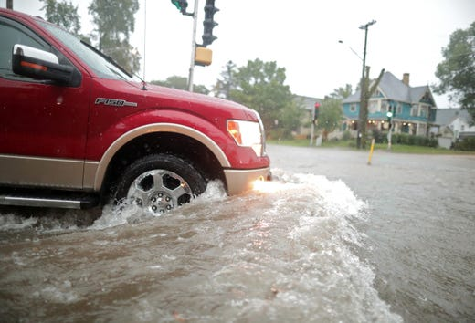 Flooding at the intersection of E. Wisconsin Ave. and Oak St. on Tuesday, August 28, 2018, in Neenah, Wisconsin