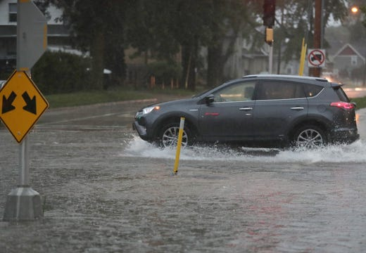 Flooding at the intersection of E. Wisconsin Ave. and Oak St. on Tuesday, August 28, 2018, in Neenah, Wisconsin. Wm. Glasheen / USA TODAY NETWORKWisconsin