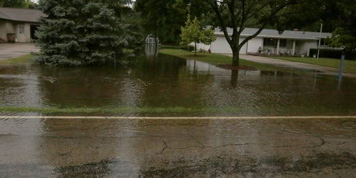 The trenches spilled over Oakwood Rd north of State Highway 21 into homeowner yards. Minor flooding occurred in the Oshkosh and surrounding areas following a violent thunderstorm and torrential rains. There have been reports of tornadoes in surrounding counties on Tuesday, August 28, 2018 in Oshkosh, Wisconsin. Joe Sienkiewicz / USA Today NETWORK-WISCONSIN