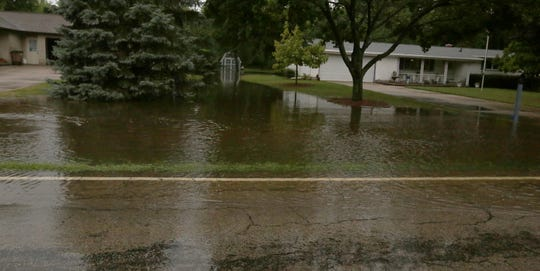 The ditches were overflowing into homeowners yards along Oakwood Rd just north of State Highway 21.  Minor flooding occurred in the Oshkosh and surrounding areas after a severe thunderstorm dump torrential rains and there were reports of tornados in surrounding counties, Tuesday,  August 28, 2018, in Oshkosh, Wis. Joe Sienkiewicz/USA Today NETWORK-Wisconsin