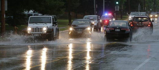 Vehicles drive through the street flooding on 9th Avenue and Huntington Place. Minor flooding occurred in Oshkosh and the surrounding area following a severe thunderstorm, torrential rains, and there were reports of tornadoes in surrounding counties, Tuesday, August 28, 2018, in Oshkosh, WI. Joe Sienkiewicz / USA Today NETWORK Wisconsin