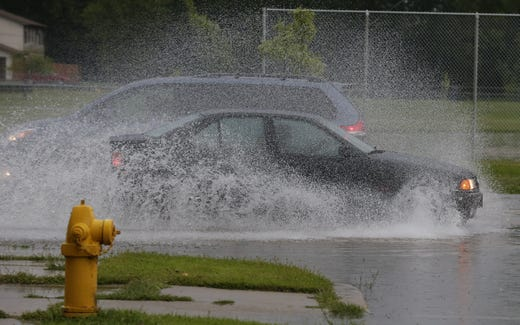Vehicles pass each other on flooded Sawyer Street. Minor flooding occurred in Oshkosh and the surrounding area following a severe thunderstorm, torrential rains, and there were reports of tornadoes in surrounding counties, Tuesday, August 28, 2018, in Oshkosh, WI. Joe Sienkiewicz / USA Today NETWORK Wisconsin