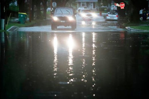 Vehicles stop after heavy rains on Tuesday, August 28, 2018, on a flooded road on the west side of Green Bay in Green Bay, Wisconsin.