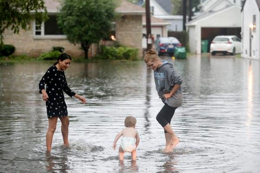 Residents are waiting for flooding on the west side of Green Bay after heavy rains on Tuesday, August 28, 2018 in Green Bay, Wisconsin.
