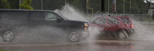 Vehicles pass through Sawyer Street. Minor flooding occurred in Oshkosh and the surrounding area following a severe thunderstorm, torrential rains, and there were reports of tornadoes in surrounding counties, Tuesday, August 28, 2018, in Oshkosh, WI. Joe Sienkiewicz / USA Today NETWORK Wisconsin