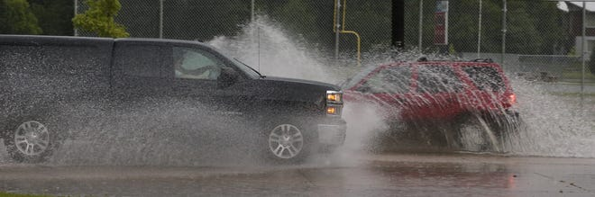 Vehicles pass each other on Sawyer Street.  Minor flooding occurred in the Oshkosh and surrounding areas after a severe thunderstorm dump torrential rains and there were reports of tornados in surrounding counties, Tuesday,  August 28, 2018, in Oshkosh, Wis. Joe Sienkiewicz/USA Today NETWORK-Wisconsin