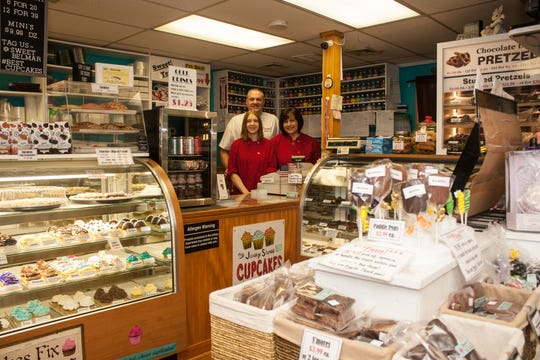 Owners of Sweet! bakery (left to right) Cali Amadio, Jason and Lena Lowe. The Belmar bakery is known for its cupcakes and cakes for all occasions.