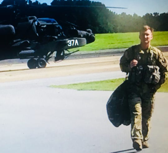 Army helicopter pilot James Casadona walking away from an Apache helicopter at Fort Campbell in Kentucky.