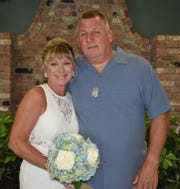 Cheri Kelcourse (left) and Roy Baker of West Allenhurst were married on Saturday at Monmouth Park.