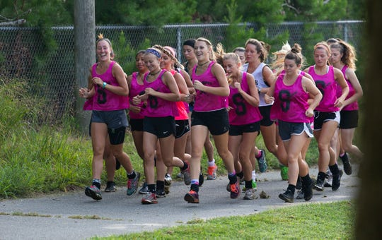 Southern Regional Field Hockey team take a lap around their fields to warm up before practice.