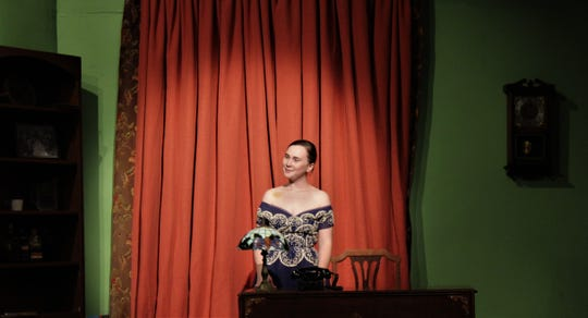 """Margot (CC Goad) is framed by a curtain that later in """"Dial M For Murder"""" will become a key prop in this rehearsal scene from Abilene Community Theatre's season-opening production."""