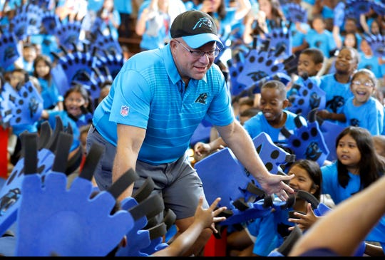 """Carolina Panthers owner David Tepper greets students during a """"kickoff rally"""" at Thomasboro Academy in Charlotte, N.C., Tuesday, Aug. 28, 2018. Tepper's charitable foundation along with several players groups and other partners will provide over 12,000 backpacks full of supplies to 17 elementary schools in Charlotte-Mecklenburg Schools, as well as an additional school in Kannapolis City Schools. (AP Photo/Chuck Burton)"""