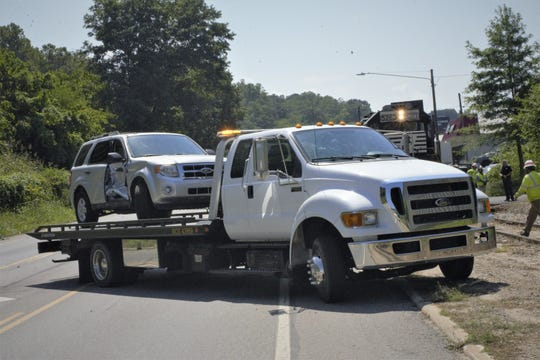 A vehicle that was struck by a train Tuesday afternoon sits on the bed of a tow truck.