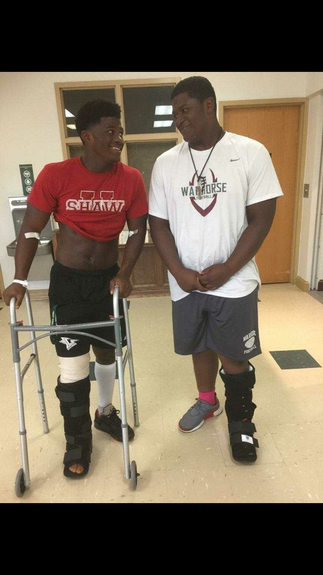 Sidney Gibbs (left) smiles with his younger brother Saevion Gibbs at the hospital after Sidney  sustained a tibial shaft fracture.