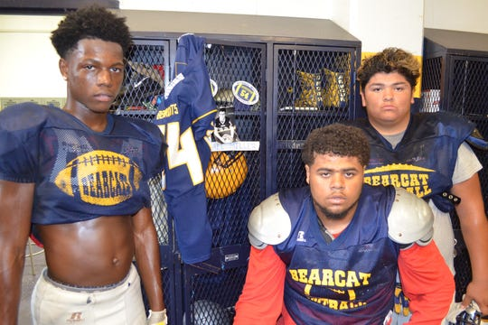 Battle Creek Central has set up a locker in memory of former teammate Michael Miller, who died in 2017 of brain cancer. The idea for the tribute came from, from left, Siryan Brown, Eric Hopkins and Ivan Guerrero.