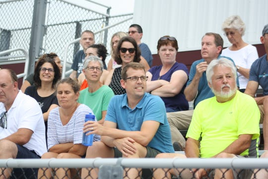Fans watch the Johnson City girls varsity soccer team compete against the Ithaca City School District at JC High School's Wildcat Stadium.