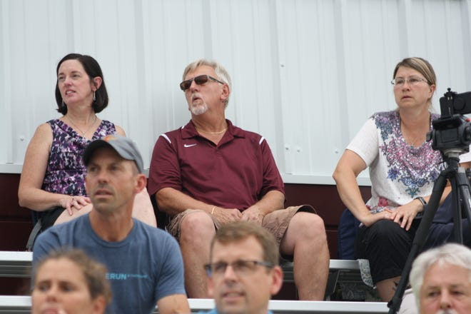 Linda Tyler, Chris Ballog and Laurie Akulis watch the Johnson City girls soccer team compete in its first game of the season.