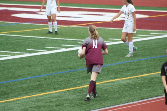 Liz Akulis carries the soccer ball during the Johnson City girls varsity soccer team's first game of the season.