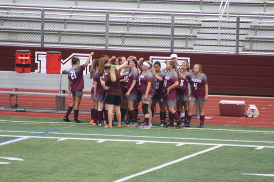 The Johnson City girls soccer team huddles before the first game of the season.