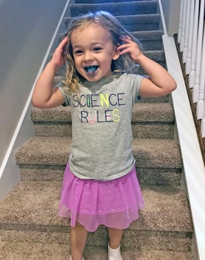 Isabella shows off her blue tongue after eating an ice pop. She asked if she could have soap to clean it off. We told her no.