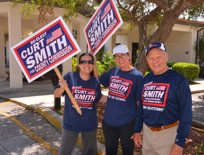 Republican incumbent District 4 County Commissioner Curt Smith joins supporters Jennifer Valliere, at left, and Courtney Barker outside the polling place at the Trinity Wellsprings Church in Satellite Beach on Tuesday afternoon.