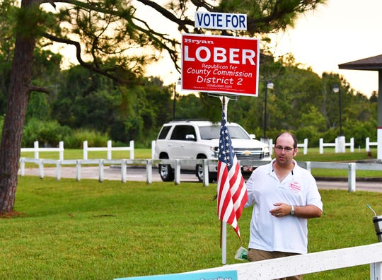 Republican District 2 County Commission candidate Bryan Lober was greeting voters Tuesday outside the polling place at the Moose Lodge on Merritt Island.