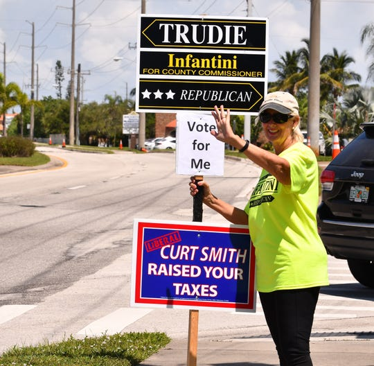 Republican District 4 County Commission candidate Trudie Infantini was at Indian Harbor Beach City Hall at lunchtime Tuesday, waving to voters.