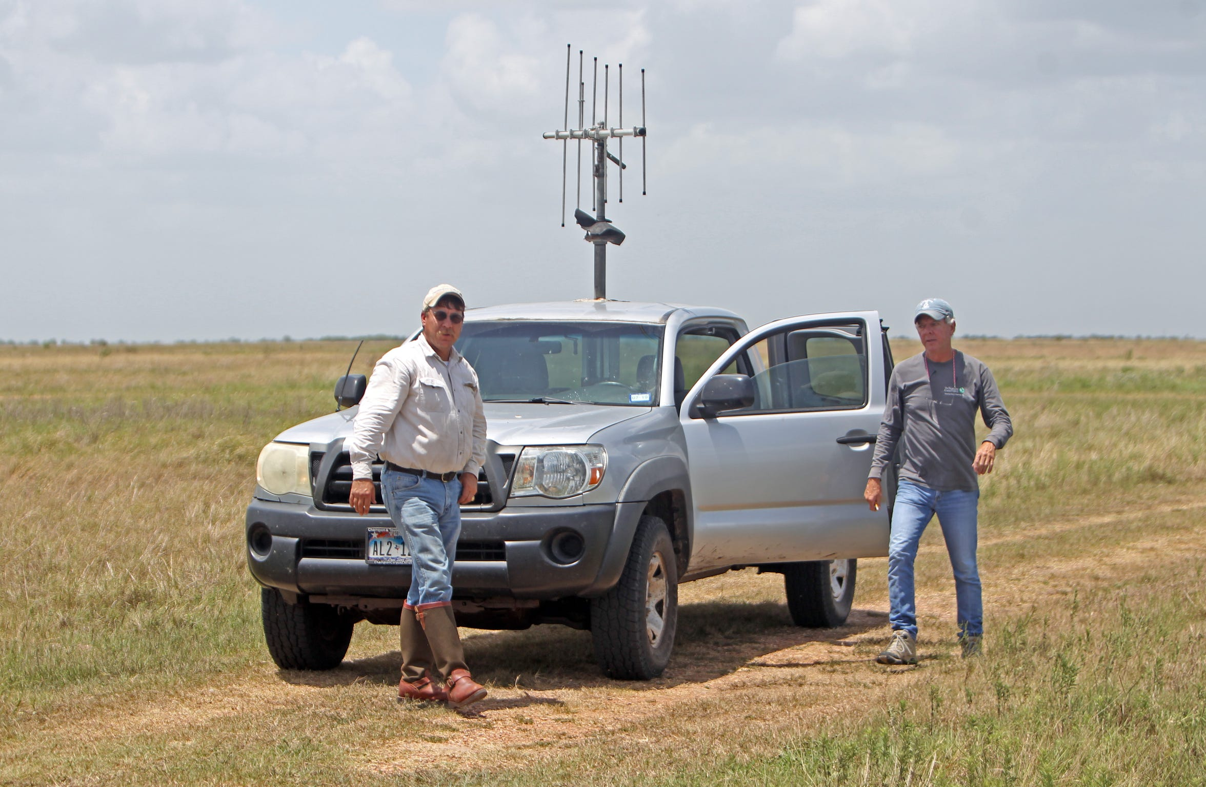 The Nature Conservancy's Kirk Feuerbacher, on left, has worked since 1997 to prepare the prairie and garner participation from ranchers, while Jay Kelso, on right, is the conservancy's Attwater Prairie Chicken savant, who works with the Goliad prairie chickens in the field almost daily.