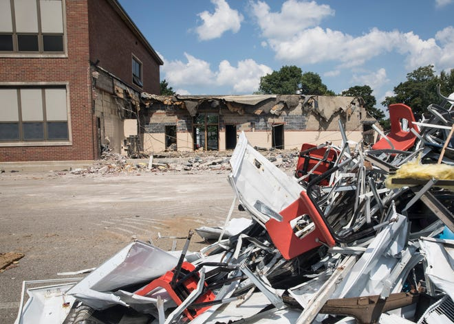 School chairs sit in a pile of rubble behind Worthington Elementary Tuesday afternoon as school demolition begins due to the creation of two new schools.