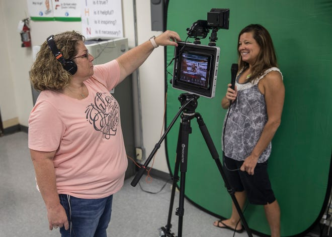 Bishop Flaget principal Laura Corcoran, left, and digital literacy teacher Christy Fay experiment with their new Podcaster to get it ready to be used by students from the fourth to eighth grade. As part of the STEM curriculum, the students will eventually be able to make their own newscast and write their own scripts according to Fay.
