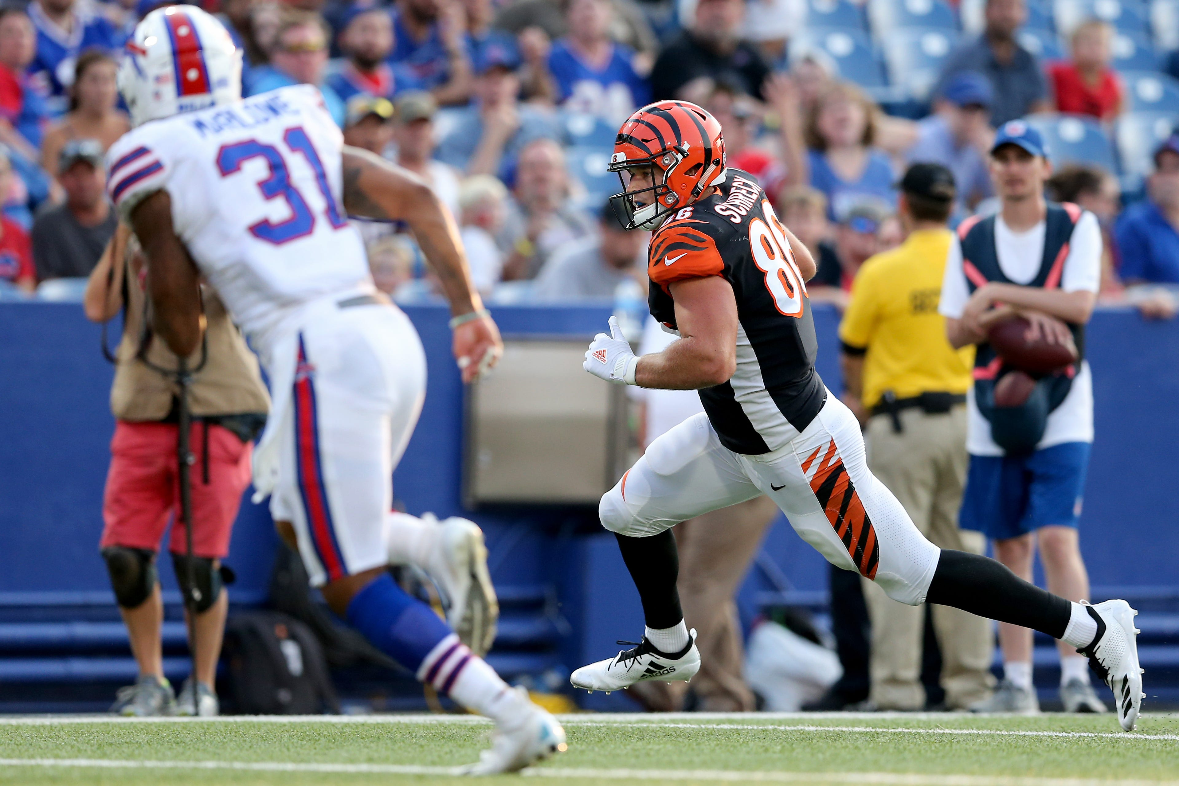 Cincinnati Bengals tight end Mason Schreck (86) runs downfield after a catch in the third quarter during the Week 3 NFL preseason game between the Cincinnati Bengals and the Buffalo Bills, Sunday, Aug. 26, 2018, at New Era Stadium in Orchard Park, New York.
