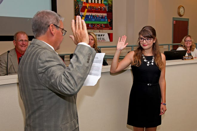New student representative of the Superintendent's Student Advisory Council Anna Impelliteri is sworn in by Judge Rick Bruggemann.