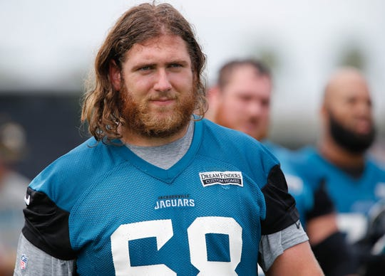 Jacksonville Jaguars offensive guard Andrew Norwell (68) walks on the field during mini camp at the Dream Finders Homes Practice Facility in June.